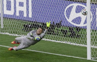 Brazil's goalkeeper Julio Cesar dives as the decisive penalty shot by Chile's Gonzalo Jara hits the goalpost in the penalty shootout during their 2014 World Cup round of 16 game at the Mineirao stadium in Belo Horizonte yesterday.