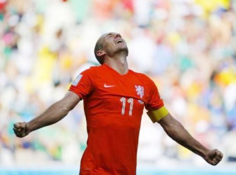 Arjen Robben of the Netherlands celebrates after winning their 2014 World Cup round of 16 game against Mexico at the Castelao arena in Fortaleza  yesterday. CREDIT: REUTERS/DOMINIC EBENBICHLER