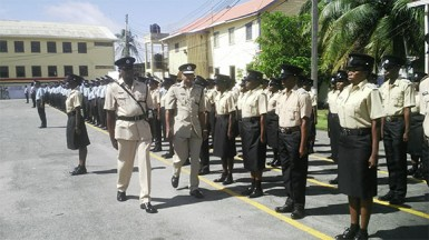 Acting Commissioner Seelall Persaud in the company of another senior officer inspecting the parade.