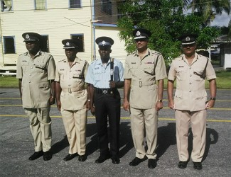 (From second left) Force Training Officer Paul Williams, Baton of Honour awardee Constable 21167 Lyken, acting Commissioner of Police Seelall Persaud and Assistant Commissioner David Ramnarine.