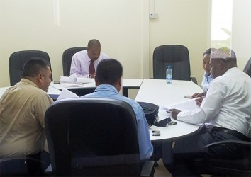 WICB vice president Emmanuel Nanthan (facing camera) meets with the Guyana Cricket Board at the Le Meriden Pegasus Hotel on Monday. Others in picture are Raj Singh, left backing camera, Anand Sanasie and Roysdale Forde.