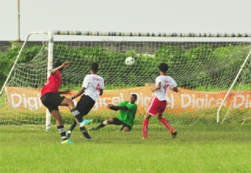Chase Academy's Isiah Reddy (left) in the process of securing his team's fifth goal