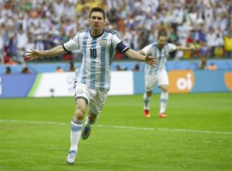 Argentina's Lionel Messi celebrates after scoring against Nigeria yesterday. (Reuters photo)