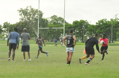 The national team in action during their final practice session yesterday at the National Park. (Orlando Charles photo)