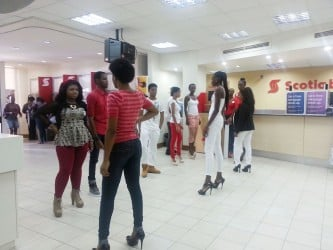 The models performing the skit.