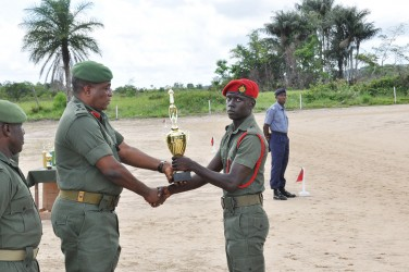Private Delroy Blackett (right) receiving his prize for the best performance at Camp Seweyo (GDF photo)