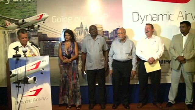 President Donald Ramotar (third from right), Public Works Minister Robeson Benn (fourth from right) and spouse (fifth from right), Minister of Tourism (ag) Irfaan Ali (right) and Dynamic Airways Vice President Tom Johnson (second from right) at the launch of the airline. At rostrum is Gerry Gouveia. (GINA photo)