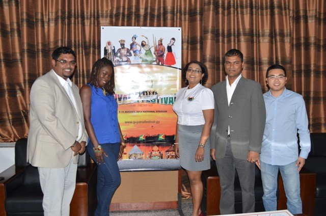 "From left are: Minister of Tourism (ag) Irfaan Ali, Melissa ""Vanilla Roberts, Guyana Festival Coordinator Tameca Sukhdeo- Singh and Representatives of Windsor Estate and Baishan Lin at the handing over of a cheque towards the Guyana Festival. (GINA photo)"