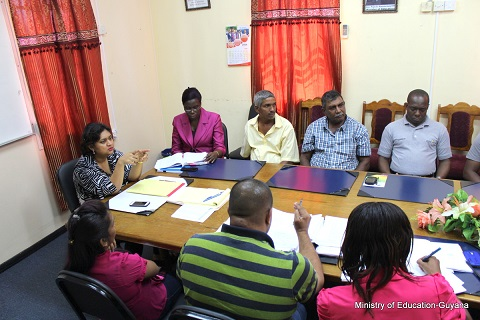 Education Minister Priya Manickchand (at head of table) in discussion with some of the contractors. (Ministry of Education photo)