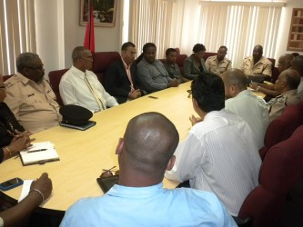 The Minister, the police, miners and others in discussion today. (Ministry of Natural Resources photo)