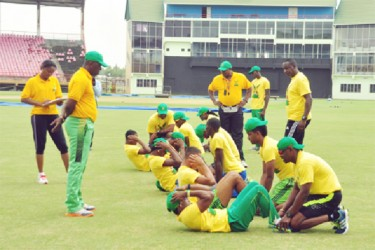 The U-19 players doing sit-ups under the watchful eyes of the senior players