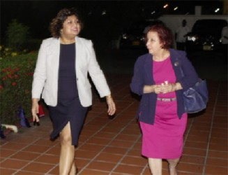 Acting Minister of Foreign Affairs Priya Manickchand (left) and Presidential Advisor on Governance Gail Teixeira leaving the reception last evening.