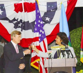 Acting Foreign Affairs Minister Priya Manickchand toasting with outgoing US Ambassador Brendt Hardt following the ruckus sparked by her remarks.