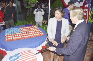 Acting Minister of Foreign Affairs Priya Manickchand and outgoing US Ambassador to Guyana, Brent Hardt cutting the cake at the 238th independence anniversary of the United States of America at the ambassador's residence at Cummings Lodge on Wednesday evening. Manickchand's scathing attack on the Ambassador at the event evoked loud boos and jeering from the gathering. (GINA photo)
