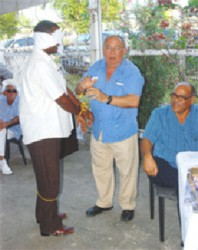 Not a hold-up: Patrick Pereira (centre) in 2010 at a Guyana Gold and Diamond Miners Association meeting demonstrating how new mining regulations would emasculate the industry.