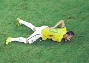 Brazil's Neymar grimaces after a challenge by Colombia's Camilo Zuniga (unseen) during their 2014 World Cup quarter-finals against Colombia at the Castelao arena in Fortaleza yesterday. REUTERS/Fabrizio Bensch