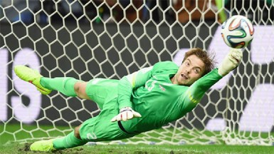 Goalkeeper Tim Krul of the Netherlands saves the last penalty shot against Costa Rica during a penalty shootout. (Reuters/Marcos Brindicci)