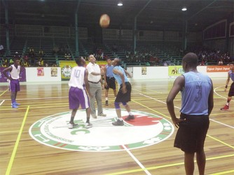 Minister of Culture, Youth and Sports, Dr Frank Anthony opening the tournament with the ceremonial jump ball