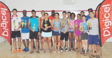 Alex Arjoon (right) in front row and Mary Fung-A-Fat (second from right) in front row pose with the other winners