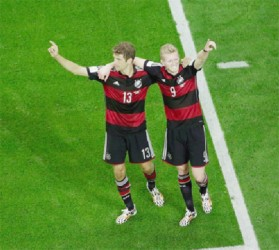 Andre Schuerrle of Germany (R) celebrates scoring his team's seventh goal and his second of the match with Thomas Mueller during the 2014 FIFA World Cup Brazil Semi Final match between Brazil and Germany yesterday. (FIFA.com photo)