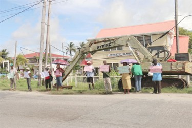Plaisance residents turned out in modest numbers yesterday to protest in front of the Plaisance/Industry NDC