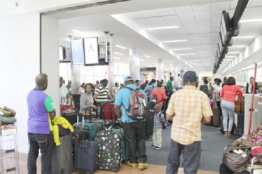 Flashback - Passengers being checked in for a Dynamic Airways return flight to Guyana at the Atlantic City Airport.