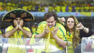 Emotional Brazil fans react after being defeated by Germany 7-1 during the 2014 FIFA World Cup Brazil Semi Final match between Brazil and Germany at Estadio Mineirao yesterday. (FIFA.com photo)