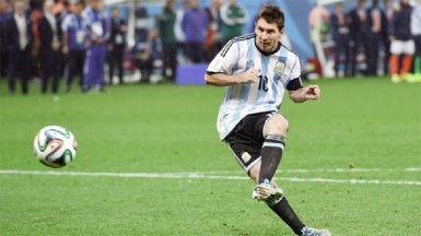 Lionel Messi of Argentina shoots and scores his penalty kick in a shootout during the 2014 FIFA World Cup Brazil Semi Final match between the Netherlands and Argentina at Arena de Sao Paulo yesterday. (FIFA.com photo)