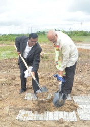 Director of Sun and Sand Hotels Bhushan Chandna (left) and President Donald Ramotar turn the sod for the planned hotel yesterday.