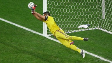 Sergio Romero of Argentina saves the penalty kick of Wesley Sneijder of the Netherlands (not pictured) in a shootout during the 2014 FIFA World Cup Brazil Semi Final match between the Netherlands and Argentina at Arena de Sao Paulo yesterday. (FIFA.com photo)