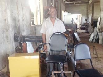 Businessman Ivor Bunbury with some of his furniture