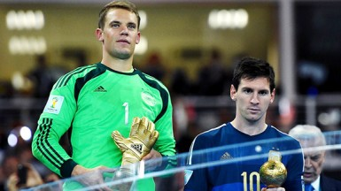 Manuel Neuer of Germany (left) receives the Golden Glove trophy and Lionel Messi of Argentina receives the Golden Ball (FIFA.com photo)