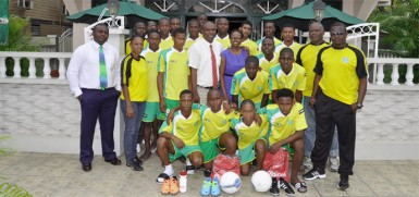 The National under-17 football team in a photo opportunity with president of the GFF, Christopher Matthias and members of the travelling contingent.