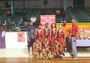 Ladies division champs, Kwakwani Secondary showing off their championship and individual titles