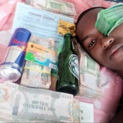 Kevin Fields posed with piles of money, a bank card, a paper with the words firearm licence printed at the top, a can of Red Bull and a Heineken bottle on his Facebook page.