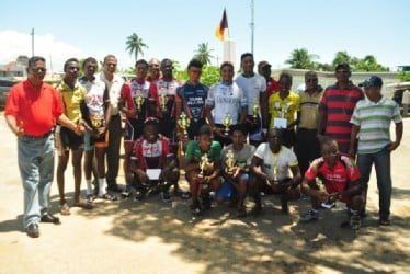 Sunday's prize winners posing with their earnings following the annual Ballox Box Martyrs 55-mile road race in Berbice. (Orlando Charles photo)