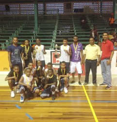 U-14 champs, Kwakwani Secondary displaying their haul following their close win over Marian Academy