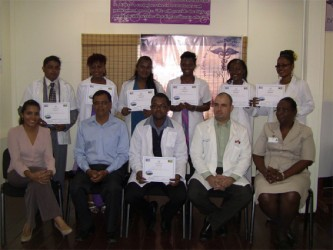 The seven new doctors displaying their certificates, with BRHA CEO Dr Vishwa Mahadeo, Dr Javier Lopez, Matron Lyken and Hospital Superintendent Melissa Ramdeen.