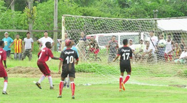 Bush Lot Secondary custodian Shane James making a critical penalty kick save from James Chand of Port Kaituma Secondary during his side's 3-1 victory.