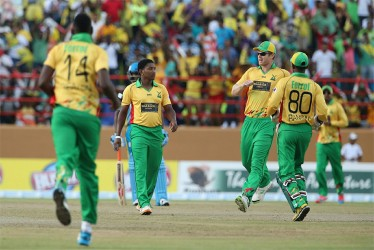 Guyana Amazon Warriors celebrate a Krishmar Santokie wicket on the way to a convincing win over the St Lucia Zouks at the Guyana National Stadium, Providence yesterday. (Getty Images)