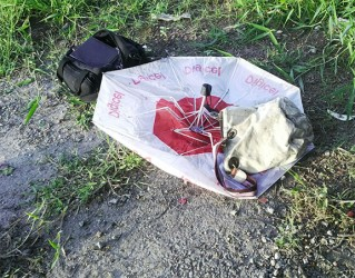 The Digicel Umbrella and the handbag believed to belong to Nygozi Goodman
