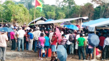 Hundreds of squatters gathered around the makeshift hall from which APNU MP Joseph Harmon addressed them (Photo by Chevy Devonish)