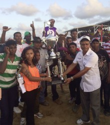 Lisa Kissoon, owner of Red and Lovely accepting the winner's trophy for yesterday's feature D1 and Lower event.