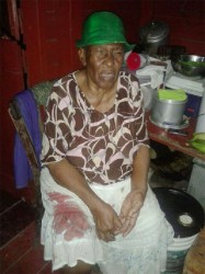 The dead man's mother Ernestine Richmond with some of her son's blood still soaked into her skirt.
