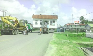 Much care and patience went into moving this house at Lancaster, Corentyne, Berbice on Sunday.