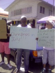 Bartica residents protesting yesterday over prolonged blackouts.