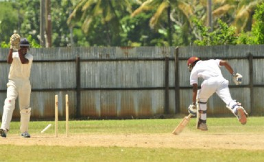 Windward Islands wicketkeeper Anson Latchman (left) running out Trinidad and Tobago's Samuel Roopnarine during their WICB u-19 three day match-up