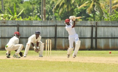 Joint top scorer Brian Christmas of Trinidad and Tobago unleashing a straight drive during his side's crushing loss to the Windward Islands