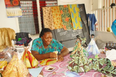 Patricia Helwig works on her African designs