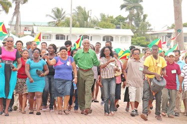 David Granger (centre) being led by his supporters into the Congress Hall yesterday.